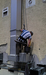 Outdoor duct works using rope access technology